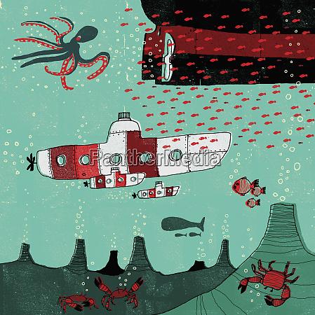 submarines traveling underwater in ocean