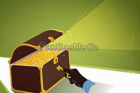 handoeffnungsschatztruhe voller goldmuenzen