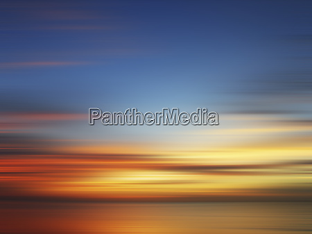 blurred view of sunset over water