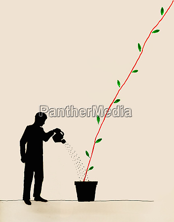 businessman watering plant forming growing line