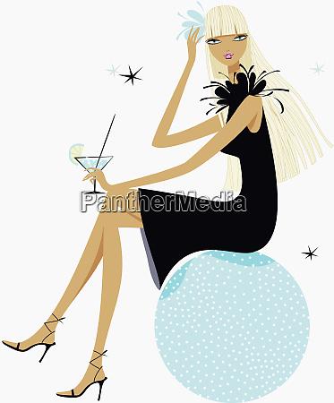 glamorous woman drinking cocktail