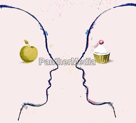apfel und cupcake auf kontrastierenden gesichtern