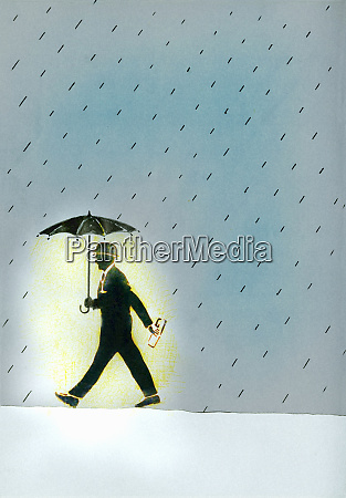 glowing businessman walking in rain with