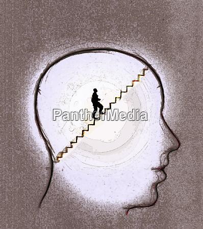 man climbing stairs inside human head
