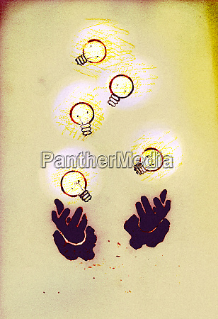 hands juggling illuminated light bulbs