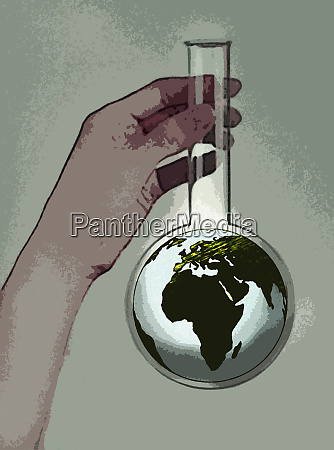hand holding beaker containing globe