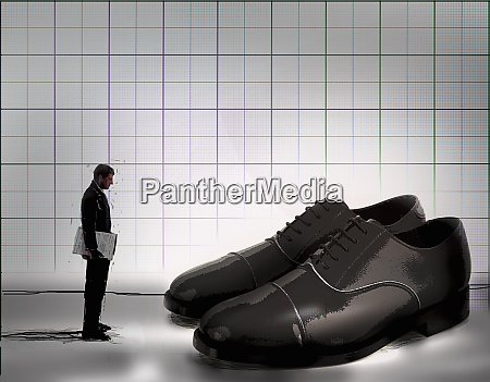 ambitious businessman looking at large pair
