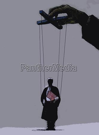 hand of businessman manipulating puppet barrister