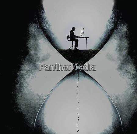 businessman working on computer inside dark