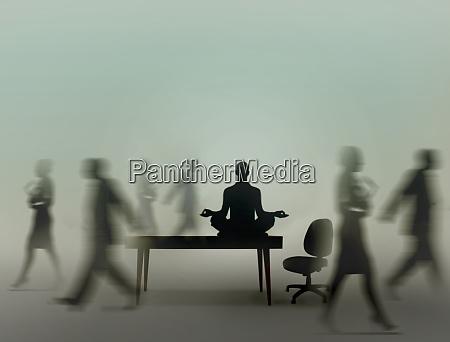 calm businessman practicing yoga meditation in