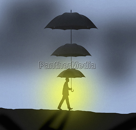 businessman with sun shining below tiered
