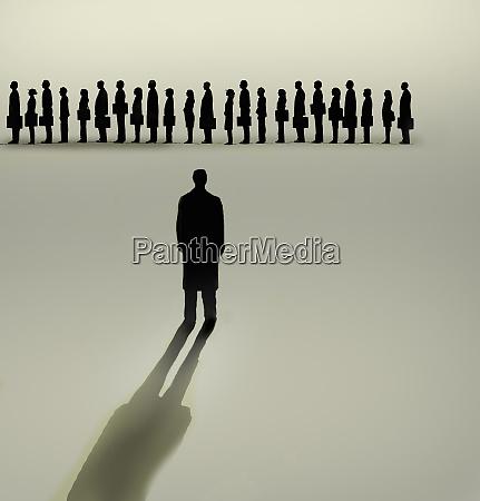 businessman looking at queue of people
