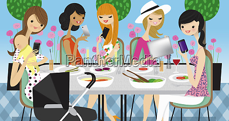 glamorous women friends using cell phones