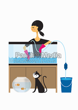 woman cleaning out fish tank