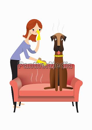 frau naehert sich stinkenden hund auf