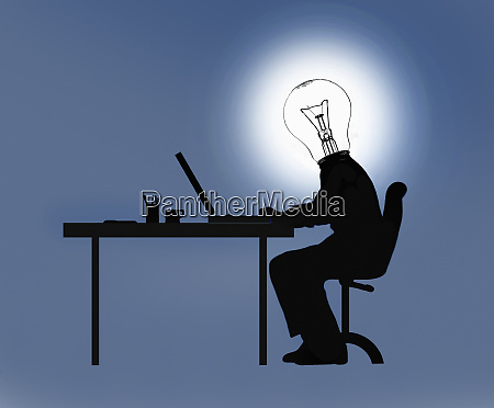 businessman working at desk with light