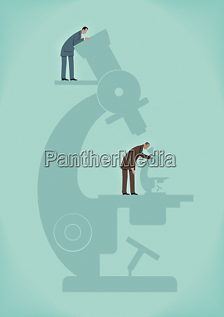 businessman with large microscope watching businessman