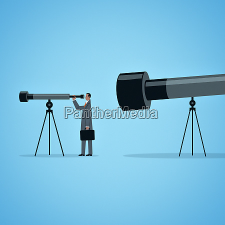 large telescope watching businessman looking through