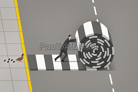 geschaeftsmann installiert crosswalk fuer enten
