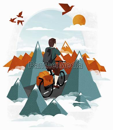 man riding bicycle among mountains