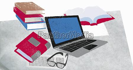 buecher laptop und brillen