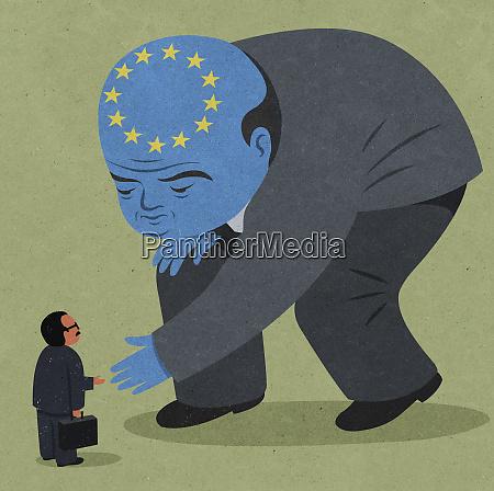 european union politician bending down to
