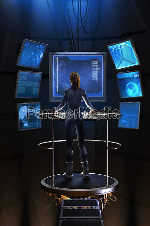 woman standing at control panel in