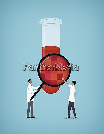 wissenschaftler pruefen chemie im reagenzglas