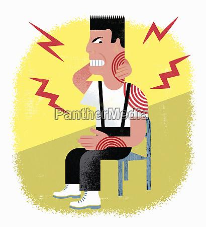 mann mit gezackten zaehnen leidet unter