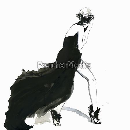 seductive woman posing wearing flowing black