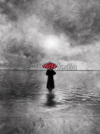 atmospheric solitary woman with red umbrella
