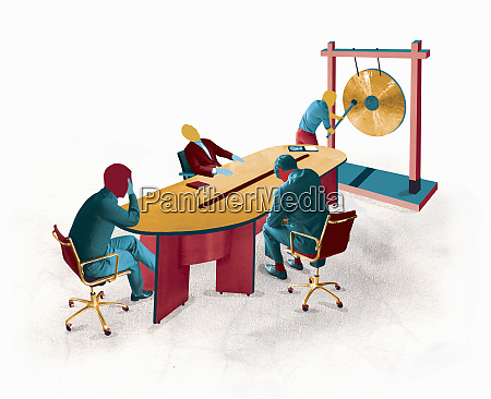 businessman banging gong in conference room