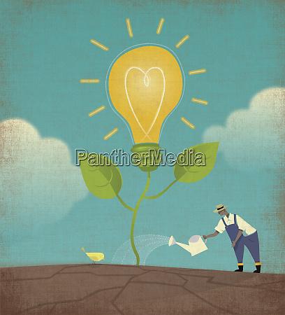 farmer watering light bulb plant