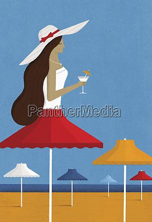beach parasol as woman wearing sun