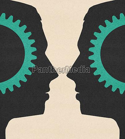 symmetrical cogs inside of mens heads