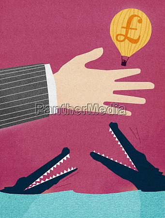 businessman releasing british pound hot air