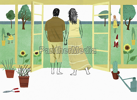 couple holding hands looking out at