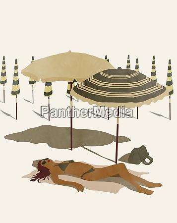 woman in bikini sunbathing on deserted