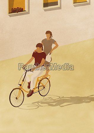 man riding bike with woman standing