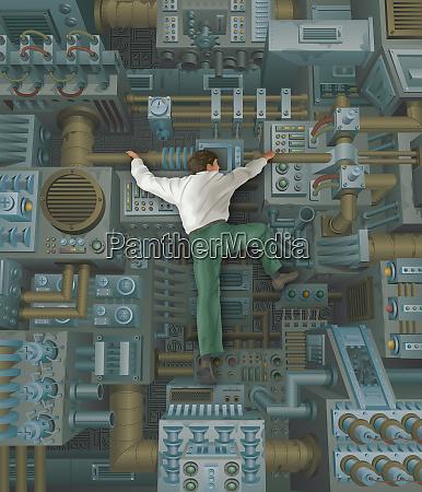 businessman, climbing, inside, of, large, machine - 26015570