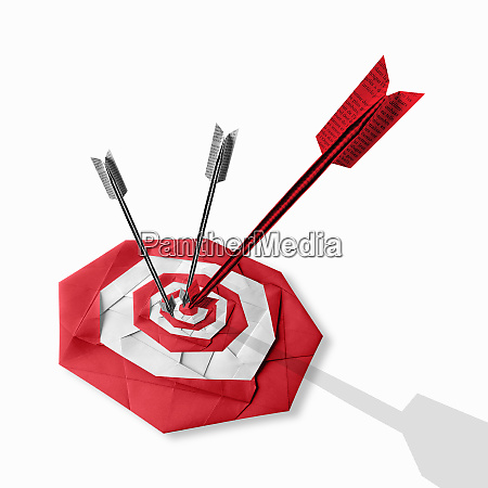 folded paper arrows hitting target