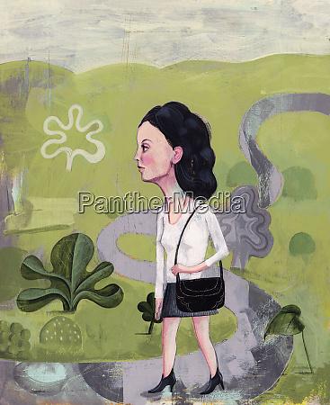 businesswoman walking on curving path through