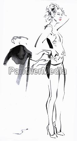 dressmaker fitting clothes on fashion model