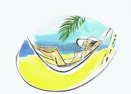 beautiful woman sunbathing in hammock on