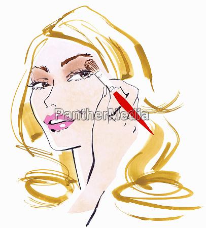 close up beautiful woman applying eyeshadow