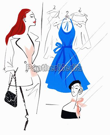 beautiful woman shopping admiring blue dress