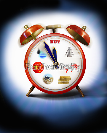 alarm clock with commodities on clock