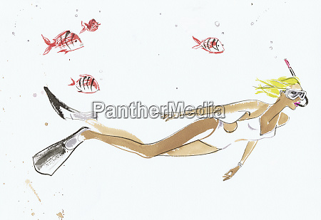 young woman snorkeling underwater