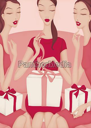 friends watching beautiful woman opening gifts