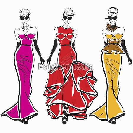 three elegant fashion models side by